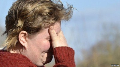 Farmer Hayley Matthew reacts as she leaves her property in the village of Moorland