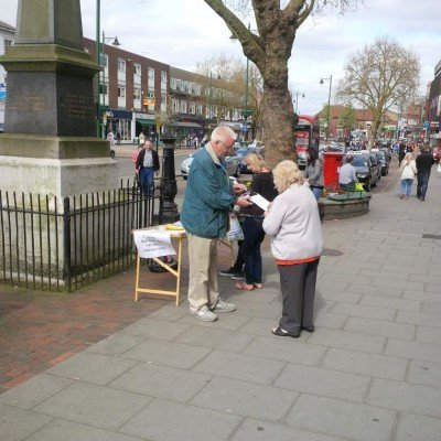 Chris Stanley collecting names for the petition to keep free Staturday afternoon car parking.