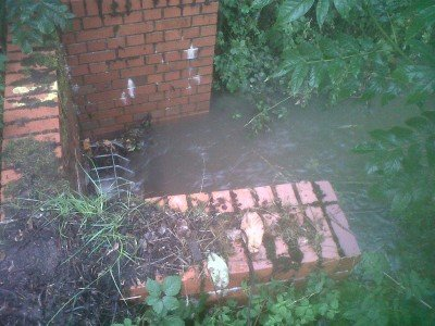 Ditch in Sweyne Park., after nearby residents had unlocked most of the grille