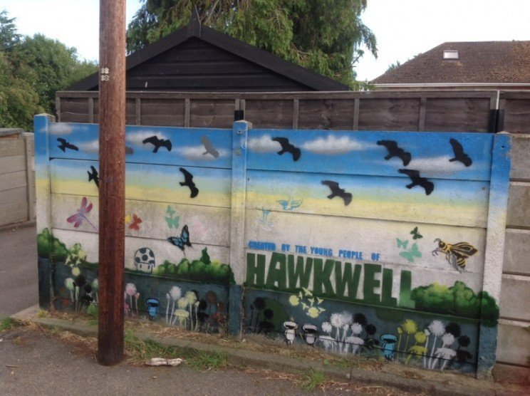 There's a car park at the entrance  , with an extensive mural by local young people.